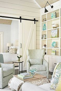 love the barn door between bedroom and seating area