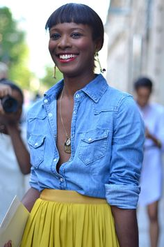 denim shirt and bright yellow pleated skirt