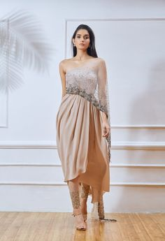 Nude crepe overlap tube kurta with side cut out on one side & beige embellished attacked dupatta drape. Indian Wedding Outfits, Indian Outfits, Indian Clothes, Indian Designer Outfits, Designer Dresses, Stylish Dresses, Fashion Dresses, Formal Dresses, Indian Gowns Dresses