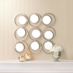 by Accent Plus Beautiful circles and round mirrors collide to create this dramatically modern wall decor. The iron framework holds nine circular mirrors that will reflect light around your living space in style.