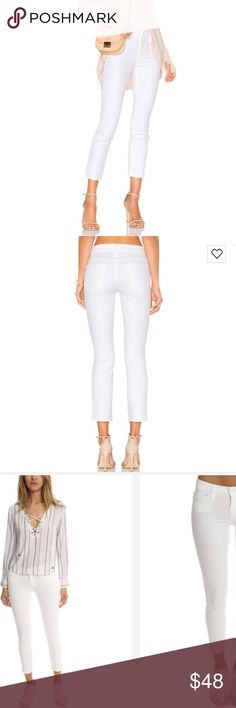 Mother - The Looker Crop - White White jeans are a wardrobe necessity and these are the perfect pair. With ample stretch and a cropped hem, these skinnies allow full mobility while they elongate your leg, and flatter your figure. These are white jeans you'll be wearing long after labor day! Minimal wear <10x. Originally purchased from Revolve. Celeb favorite - Eva Longoria, Candice Swanepol, Alessandra Ambrosio and more  Skinny fit Five-pocket styling Machine wash Cotton, lyocell, Elastane…