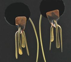 """Art Smith Modernist Kinetic Earrings, 1950. One of the leading modernist jewelers of the mid-twentieth century, Smith trained at Cooper Union. Inspired by surrealism, biomorphicism, and primitivism, Art Smith's jewelry is dynamic in its size and form. Although sometimes massive in scale, his jewelry remains lightweight and wearable. See """"From the Village to Vogue: The Modernist Jewelry of Art Smith""""."""