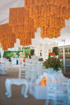 10/15/2012: At the Veuve Clicquot Polo Classic, a collection of six marigold chandeliers filled the V.I.P. tent ceiling, each standing eight feet high and made from thousands of strands of silk marigolds in the brand's recognizable yellow shade.  Photo: Claire Barrett Photography