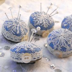 Beautiful art of embroidery is not forgotten - Embroidered Snowflake Pincushion Brooches by Wychbury, via Flickr.