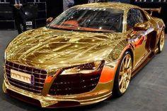 Gatsby drives a golden car.
