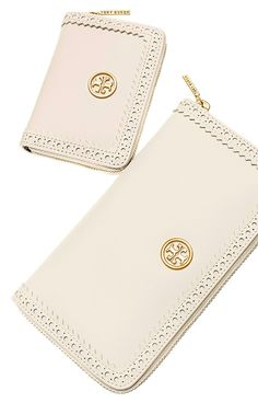 Carry the laser-cut trend into your wardrobe with the classically perforated Tory Burch Robinson spectator wallet and coin case.