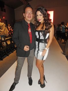 Anthony Rubio Top Pet Couturier with Top Maxim Model Carissa Rosario attending the uber fabulous Falguni and Shane Peacock runway show during SS2014 Mercedes Benz New York Fashion Week.