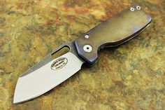 "3 inch two toned D2 blade  7.25"" Overall length  Titanium Frame lock with titanium tip up pocket clip"