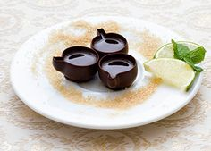 Chocolate cups with liquor, brown sugar and lime.