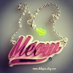 MEOW word laser cut necklace