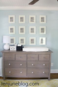 Blue walls, white frames with the brown grey dresser- much like our bedroom but wonder if the dark brown would work better to match the headboard?