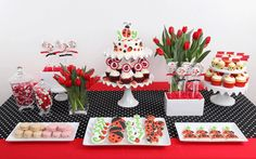Love the red table cloth & poka dot runner.  Really love this set up.