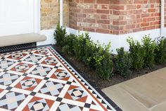 Edwardian style mosaic path and plants in London front garden
