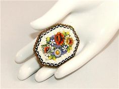 Vintage Adventure eBay listing for ANTIQUE MICRO MOSAIC PIN Brooch ITALY FLOWERS FLORAL Octagonal GLASS TILE ends July 29, 2016.
