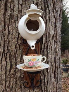 Screw a teapot and teacup to tree _ plant it out and voila