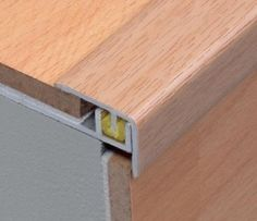 This is a 3 piece adjustable stair nosing profile for 7-9mm thick laminate flooring,consisting of an aluminium top,an aluminium base with a grooved channel and a pvc clipper .The base,which is extra wide to ensure safety of installation, can be fixed with screws or adhesive.No screws are required for the top part,as the pvc mounting clip fixes the top part to the base and adapts to the height required.The top aluminium profile has an extra hard tempered surface and available in wood finish.