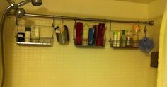 Genius!!!! 2nd shower curtain rod used to hang caddies full of toiletries