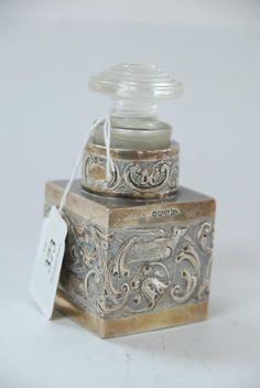 A sterling silver perfume bottle Sheffield 1904