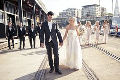 Love the colors of the bridal party- men in black and girls in tan