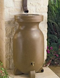 Rain barrels for water conservation.  We like the terra cotta look, the stabilizing feet and the durable brass spigot.