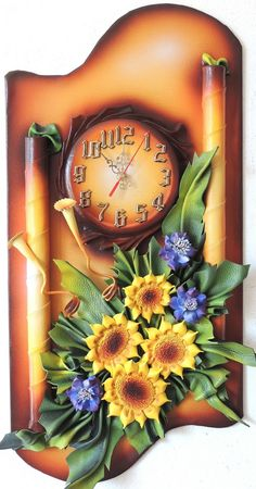 Unique 3D Leather Art Sunflowers and Cornflowers with Clock Sku:DBKZ3-40AG Size: 38cm x 70cm Color: Light and Dark Brown, Gold, Walnuts, Orange,Burgundy Material: Genuine Leather, Wood Clock requires one R6 –AA battery to operate (not included) Using silent motor Ships well protected This Unique Leather Clock collection we call Wave of the Sea. This beautiful Clock suit any taste or fit any home and office decor. These very unique Leather Clock with Flowers have a high quality embellished…