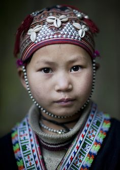 For Tet, little kids wear this traditional hat. This little girl had her hair shaved by her Red Dzao mother for the New Year.