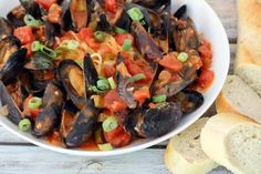 These Louisiana mussels are served with the tasty tomato-based cooking sauce and hot cooked pasta. Serve them with sliced French bread for a fabulous meal.
