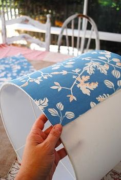 Recovering lamp shades. Spray paint thrift store lamps and use cute fabric to recover the shades!