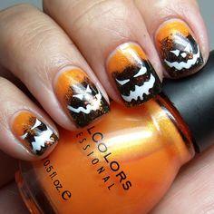 Spooky Hallowe'en Face skittle mani!!!  Boo!