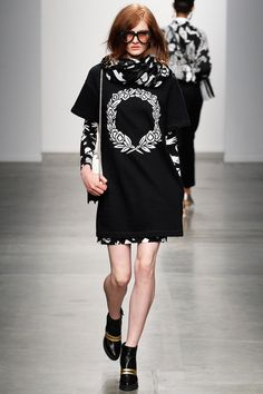This Karen Walker model looks as though she wants to eat my face, but I still like these layers from the F/W 2014 show.