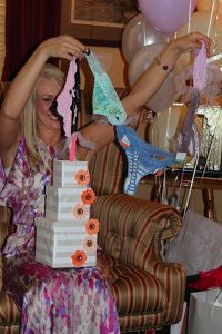 """...Bridal Shower Gift...Undies Tower...Card reads """"Pull the string and see what you'll find, maybe something cute for your little behind""""..."""
