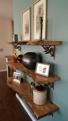 This project was made from reclaimed wood, 3 slabs cut from the same piece. They were sanded and then coated with 6 layers of satin clear coat verathane. The brackets were purchased online and attached to the wall. Wood shelving was then secured to the brackets.