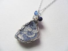 Blue and white floral English sea pottery with a lapis lazuli bead and mixed crystals wire wrapped necklace. Unique, hand crafted necklace to an original design, using beautiful English sea pottery. Lapis Lazuli, Blue And White, Pottery, English, Pendant Necklace, Sea, Crystals, Floral, Beautiful