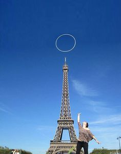 Hula Hoop Over the Eiffel Tower: http://www.hooping.org/2012/09/hula-hoop-over-the-eiffel-tower/