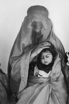 Mother and child in waiting room at a hospital in Kabul, Afghanistan.