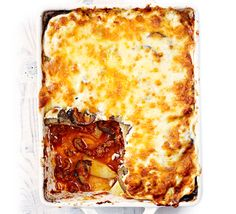 This easy Greek dish of sliced potatoes and aubergines is layered with lamb mince and topped with a creamy cheese sauce