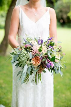 Wild flower wedding bouquet in pastel shades. Photography by Helen Cawte