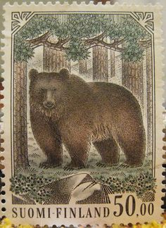 The brown bear (Ursus arctos). Stamp from Finland, circa1963