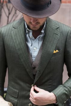 Cannot beat Dan Trepanier's layered look. Striped oxford shirt, houndstooth waistcoat, and herringbone suit jacket. Love the mixed patterns/textures and that pop of yellow in the pocket square.