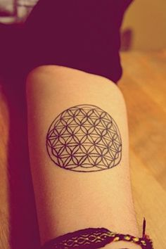 This is my flower of life tattoo that I'm in love with. And although there are some imperfections that I've spotted, I'm still head over heels for it.    I got it done at Adrenaline in Montreal by Ron Smith.