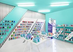 Gadget repair shop fitted out in hospital colours by Masquespacio
