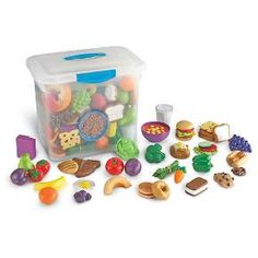 """All the yummy food you need for your dramatic play centers and early nutrition lessons. Includes 100 durable pieces packaged in a handy tote measuring 14 L x 9 ?""""w x 12 ? Learning Resources New Sprouts Classroom Play Food Set Play Food Set, Dramatic Play Centers, Play Centre, Group Meals, Food Groups, Imaginative Play, Learning Resources, Jouer, Pretend Play"""
