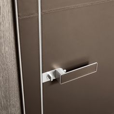 polished aluminum structure, door panel, jamb and handle covered with fango leather with cotton stitching in the same colour.