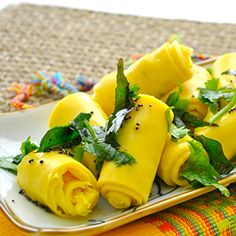 Khandvi, a mouth watering traditional Gujarati snack food also known as Surali Vadi, Suralichi Wadi, Spicy Gram Flour Rollups