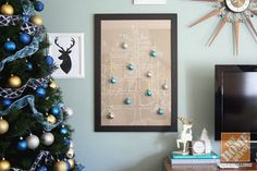 Christmas Idea: DIY your own craft paper Christmas tree! Attach ornaments with washi tape.