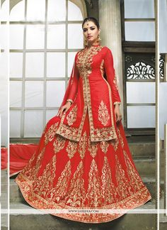 We are to breathe life into your aspirations and to make a mark in the world of style. Looking amazing with attachment of red georgette a line lehenga choli. The embroidered and resham work looks chic...