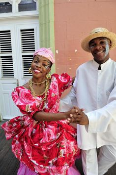 Traditional folk dancers dress in Creole costume.