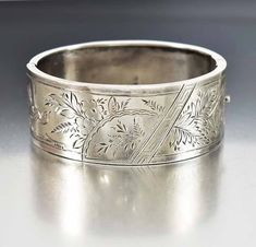 A swallow and forget me not flowers engraved with a geometric design form this English Aesthetic movement Victorian sterling silver cuff bangle bracelet. Fully hallmarked, the hinged oval cuff is comp Cheap Silver Rings, Silver Rings Handmade, Antique Jewellery Online, Antique Jewelry, Victorian Jewelry, Silver Bangles, Sterling Silver Bracelets, Silver Earrings, Silver Jewellery