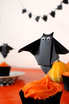 Origami Bat Party Decor | 19 Spooky & Fun DIY Ideas to Throw a Halloween Party at Your House! by DIY Ready at http://diyready.com/19-spooky-fun-diy-ideas-to-throw-a-halloween-party-at-your-house/