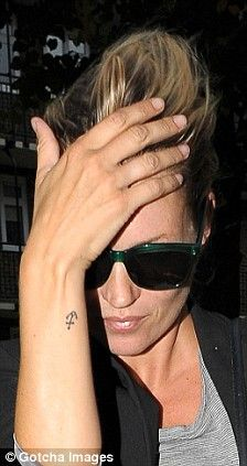 kate moss anchor tattoo-- if i EVER did, it would be this anchor on my foot. So cute!